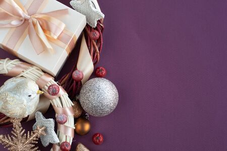 Photo pour Christmas background with gift and ornaments on purple paper background with copy space for text - image libre de droit