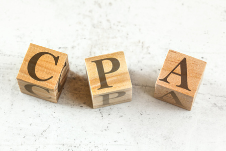 Three wooden cubes with letters CPA stands for Cost per Action Acquisition on white board.