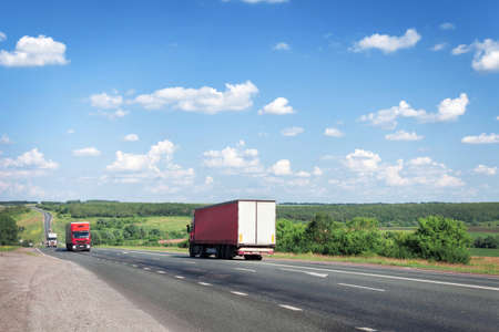 Photo for Trucks and cars drive along the summer road, the highway. - Royalty Free Image