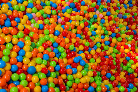 lots of colored balls in a playground ball pool