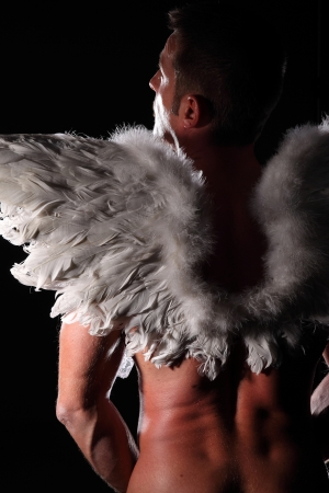 muscular man with angel wings