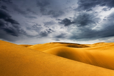 desert dune and storm sky
