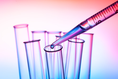 pipette and test tube in a laboratory