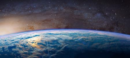 Foto de Planet Earth with appearing sunbeam light. - Imagen libre de derechos