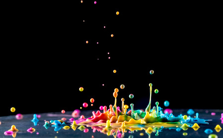 Foto de splashing color ink on black background - Imagen libre de derechos