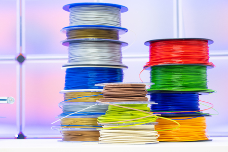 Photo pour Spools of plastic filaments for 3D Printer - image libre de droit
