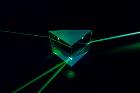 Photo pour Laser beam and optical glass on black background - image libre de droit