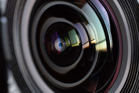 Photo pour Close-up camera lens with color reflections - image libre de droit