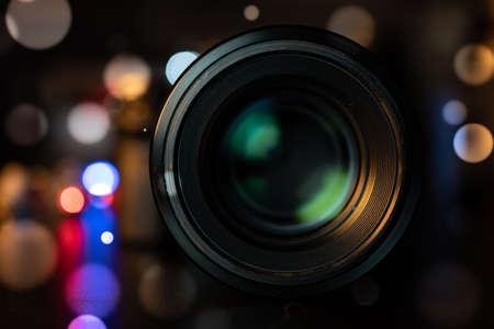 Photo pour Photo camera lens on dark bokeh background - image libre de droit