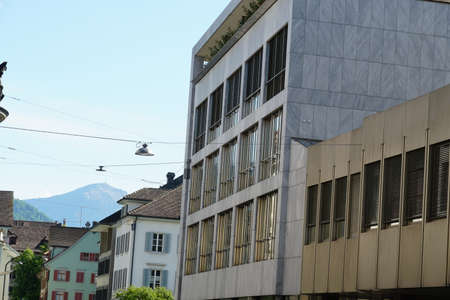 Photo pour A street with facades of different architecture styles in city center of Zug in Switzerland. - image libre de droit