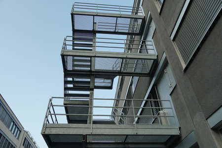Photo pour Exterior metal stairs, fire escape route, attached to outside of modern industrial and administrative brick building in Dietikon, Switzerland. - image libre de droit