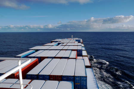Foto de Container vessel covered with snow on top of the container sailing over the Pacific ocean during winter season. - Imagen libre de derechos