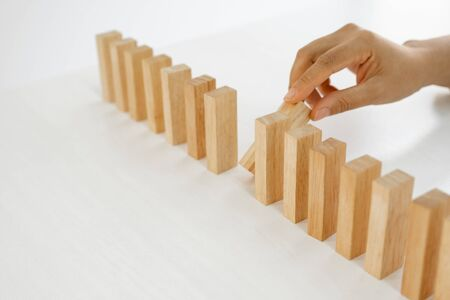Photo pour Hand holding blocks wood game, Concept Risk of management and strategy plan, growth business success process and team work. - image libre de droit
