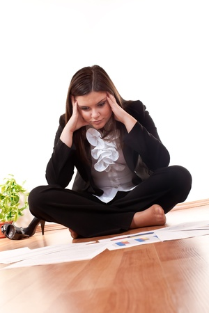 concerned business woman sitting on floor