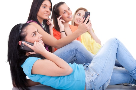 young teenagers using cell phones,  isolated white background