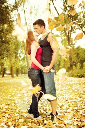 full body portrait of an attractive couple in autumn park