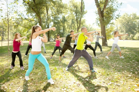 large group of young people training kickboxing, outdoor