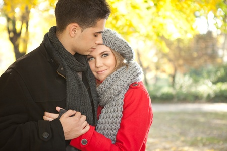 romantic young couple embracing in autumn park