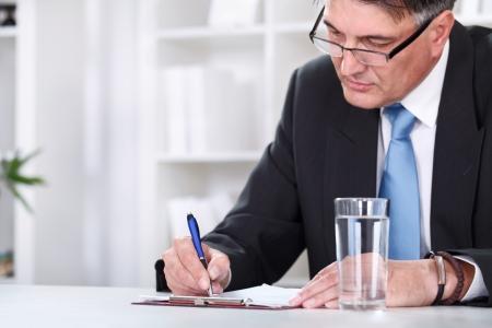 Photo pour Businessman with document,  signing a contract with  pen - image libre de droit