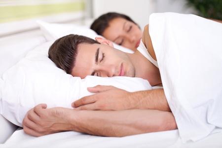Photo pour Man and woman sleeping - image libre de droit