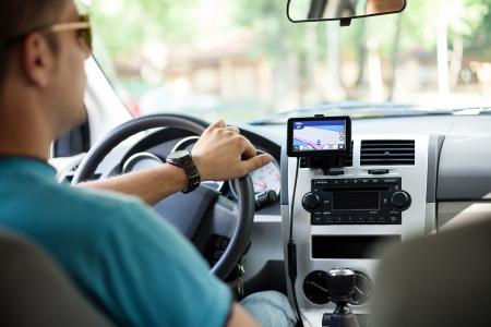 Photo pour  GPS navigation in interior of luxury car - image libre de droit