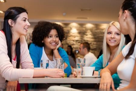 Four  young women having coffee break