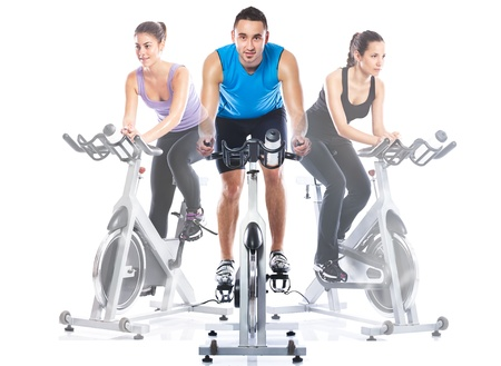Spinning training riding on  exercise bikes
