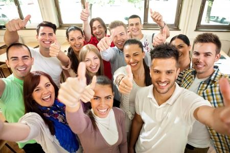 Foto de  Group of happiness students with raised hands - Imagen libre de derechos