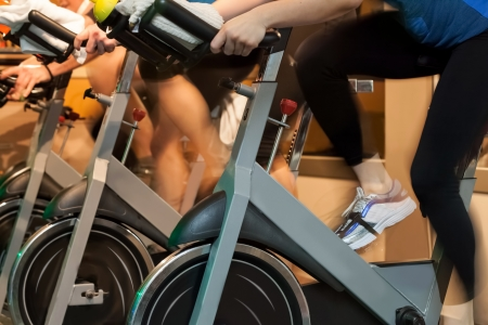 People doing sport Spinning in the gym for fitness