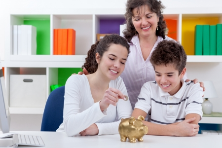 mother with her children putting money in piggybank, family saving