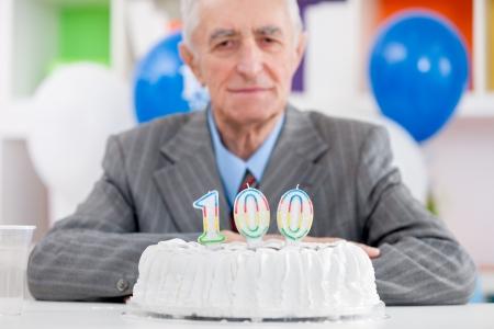 Senior man with cake on  one hundredth birthday