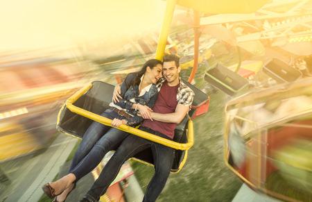 Happiness couple riding on ferris wheel at amusement park