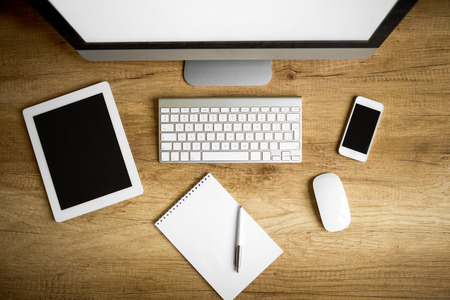 Foto de Office supplies, gadgets on wooden table, top view - Imagen libre de derechos