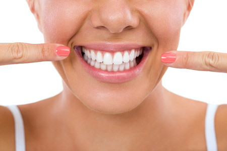 Photo pour Woman showing her perfect straight white teeth. - image libre de droit