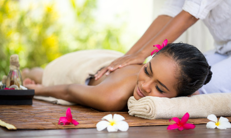 Photo for Beautiful Balinese woman getting a massage - Royalty Free Image