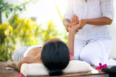woman receiving relaxation hand massage