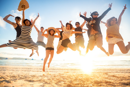 Photo pour jumping at the beach, summer, holidays, vacation, happy people concept - image libre de droit
