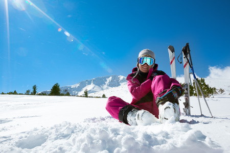Female skier resting on the ski slopeの写真素材