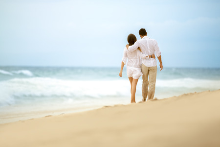 couple walking on beach, embracing love coupleの写真素材