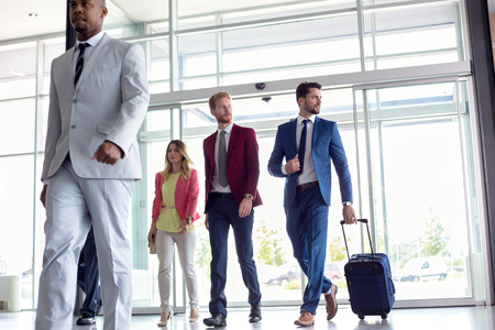 Photo pour Business people walking in airport - image libre de droit