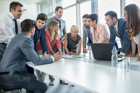 Foto per successful corporate people having a business meeting in office - Immagine Royalty Free