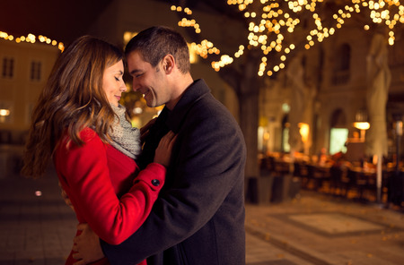 Photo pour Young happy attractive amorous couple embracing  and kissing outdoor - image libre de droit