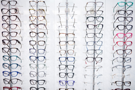 In eyewear shop can be seen large selection of frames for eyeglasses