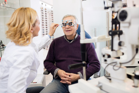 Photo for Optic specialists views eyesight to patient in eye clinic - Royalty Free Image