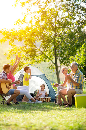 Photo pour happy family enjoying on summer day on camping - image libre de droit