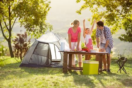 Foto de young happy family on vacation in nature - Imagen libre de derechos