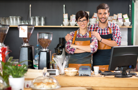 Photo for Young business owner working coffee shop - Royalty Free Image