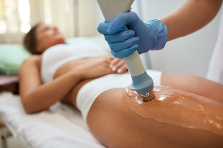 Photo for Correction cellulite figures in the beauty salon acoustic wave therapy - Royalty Free Image