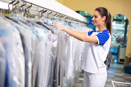 Female employees checks clothes in plastic bags