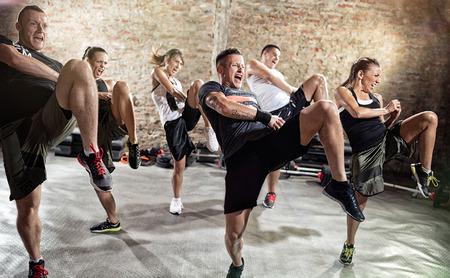 Young people  doing kick box exercise